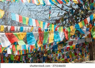 SHANGRILA, CHINA - MAR 13 2015: Prayer flag at Baiji Temple. a famous Tibetan city of Shangrila, Yunnan, China.