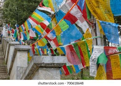 Shangri-La, Zhongdian, Yunnan Province, China April 25, 2017 :  Tibetan Prayer Flags at ancient temple in Shangri-La