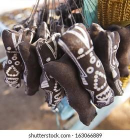 Shani Dev souvenir hanging at a market, Shani Shingnapur, Ahmadnagar, Maharashtra, India