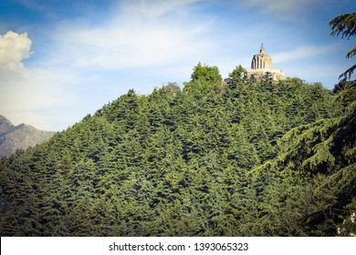 Shankaracharya temple is at a height of 1,000 feet above the plain and overlooks the city ofSrinagar,Kashmir,India.Temple in lush green forest. Temple located on top of mountain.Lush green forest.