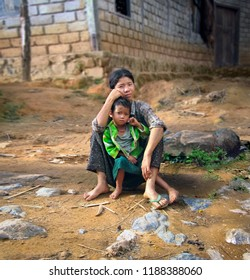 SHAN/MYANMAR - SEP 17. Unidentified local burmese woman with her little son poses for a photo on September 17, 2018 in small village in Shan State, Myanmar (Burma), Southeast Asia
