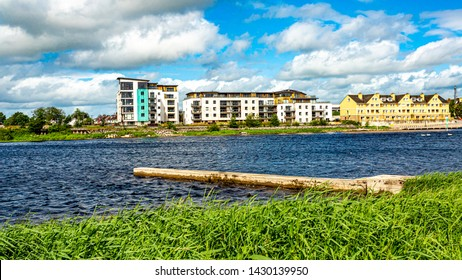 Shannon river with calm waters, some buildings in the city of Athlone in the background, wonderful spring day in the county of Westmeath, Ireland