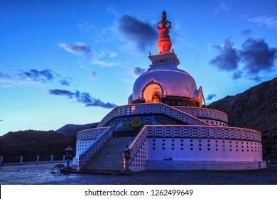 Shanti stupa illuminated in the evening twilight. Leh, Ladakh, Jammu and Kashmir, India