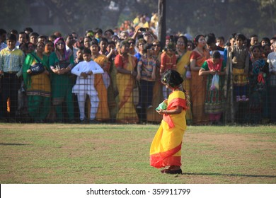 Shantiniketan, West Bengal, India- March 5, color festival of India on 5th March, 2015. A lonely little girl enjoying Holi at Shantiniketan the abode of Rabindranath Tagore.