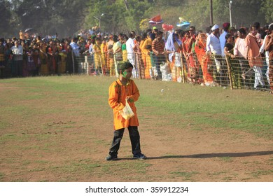 Shantiniketan, West Bengal, India- March 5, color festival of India on 5th March, 2015. A lonely little boy is enjoying Holi at Shantiniketan, the abode of Rabindranath Tagore.
