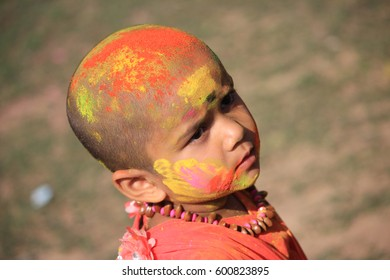 Shantiniketan, West Bengal in India on 05th March in 2015 - Portrait of a little cute girl at Holi, the color festival of India. Shantiniketan, the abode of Rabindranath Tagore.