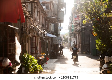 SHANTOU, CHINA - OCTOBER 25, 2017: A bike driving on the street of chinese local residential area