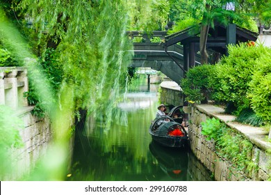 SHAOXING, CHINA - July 3, 2015: A boat man resting in the traditional row boat in Shaoxing City, Jiangsu Province, China on July 3, 2015