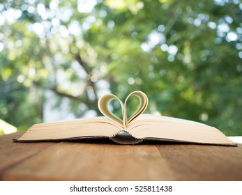 shape of a heart on a book