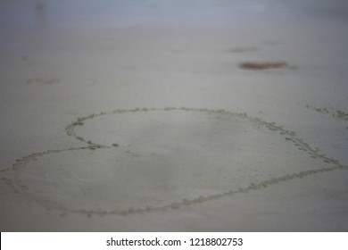 The shape of heart. Write on the sand of the sea. For write the name of sweetheart in Valentine's day, or for a wedding card. Blurred sea nutural background.
