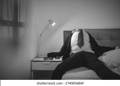 Shape of man wear coat and tie lay on bed