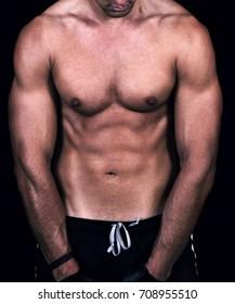 shape of sporty male body on dark