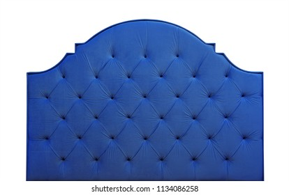 Shaped dark navy blue color soft velvet fabric capitone bed headboard of Chesterfiels style sofa isolated on white background, front view