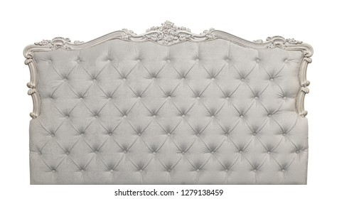 Shaped grey soft velvet fabric capitone bed headboard of Chesterfield style sofa with carved wooden frame, isolated on white background, front view
