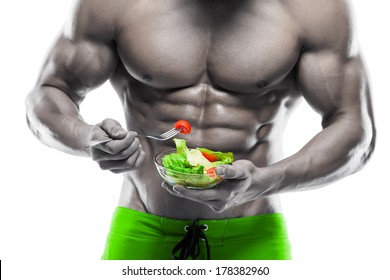 Shaped and healthy body man holding a fresh salad bowl,shaped abdominal, isolated on white background, colored retouched