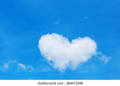 shaped heart white cloud in the blue sky