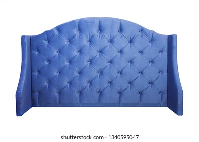 Shaped indigo blue color soft velvet fabric capitone bed headboard of Chesterfiels style sofa isolated on white background, front view