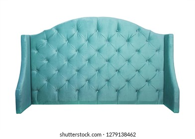 Shaped pastel teal blue color soft velvet fabric capitone bed headboard of Chesterfiels style sofa isolated on white background, front view