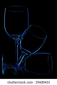 shapes of 3 wineglasses over black