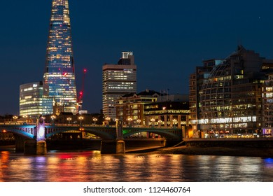 The Shard behind Blackfriars bridge at night, London, United Kingdom