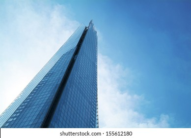 The Shard towering over London, photographed in London, UK. Built in 2012 and standing 306 meters tall, the Shard is currently the tallest building in the European Union and a new London attraction.
