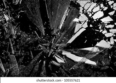 Shards of shattered glass with reflecting light.