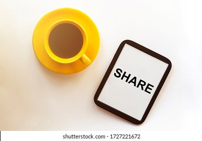 share Coffee and tablet on the table. Pause and coffeetime. Blue cup and mocup pad.