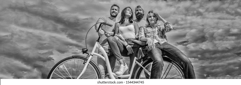 Share or rental bike service. Bicycle as best friend. Company stylish young people spend leisure outdoors sky background. Cycling modernity and national culture. Group friends hang out with bicycle.