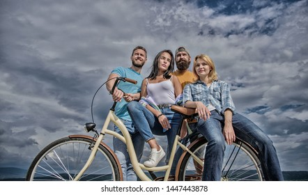 Share or rental bike service. Group friends hang out with bicycle. Bicycle as best friend. Company stylish young people spend leisure outdoors sky background. Cycling modernity and national culture.