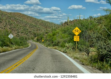 share the road with bicycles sign on empty road in arizona