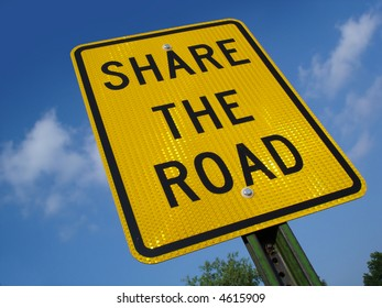 Share the road sign.
