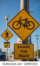 Share the Road - yellow waring sign, bicyclist and pedestrians crossing