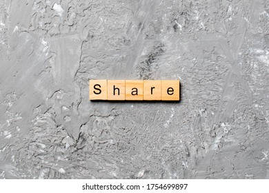 share word written on wood block. share text on table, concept.