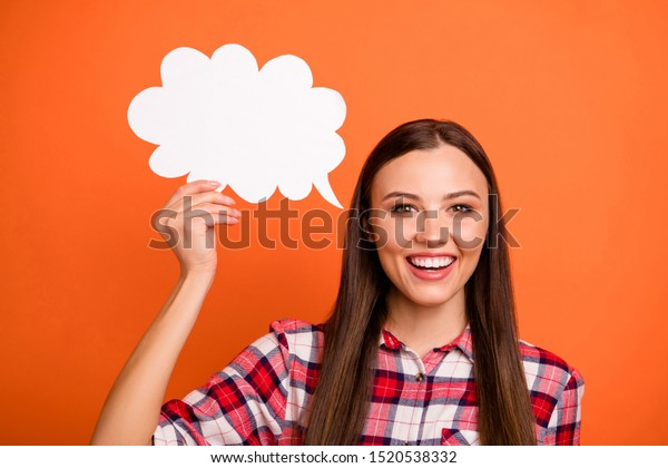 Share your point of view with us! Closeup photo of pretty cute excited dreamy teenager expressing her feelings by language holding white speech bubble in hand isolated bright background