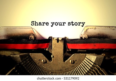 SHARE YOUR STORY typed words on a vintage typewriter