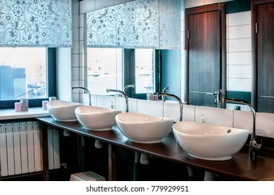 Shared bathroom in the hotel without people. Bathroom interior