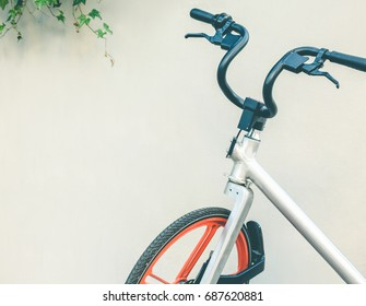 shared bicycle isolated against white wall.
