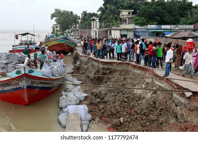 Shariatpur, Bangladesh-September 10, 2018: Erosion of the Padma River bank at Naria in Shariatpur has taken a serious turn in area recently as ten thousands houses, shops and roads have been engulfed.
