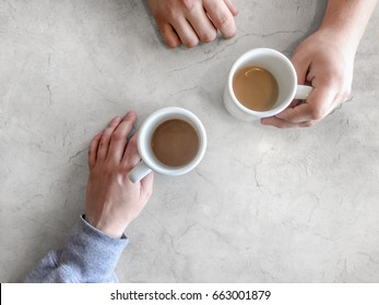 Sharing coffee white marble table, top view