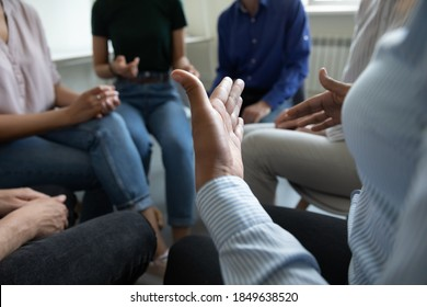 Sharing ideas. Close up view of diverse people group gathered in circle at workplace office cabinet to discuss work or self problems, share points of view, listen to mates, feel psychological support