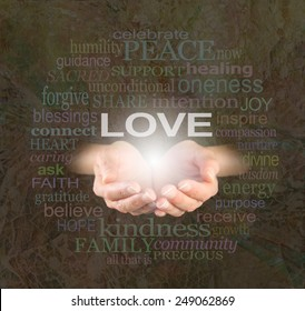 Sharing Love with You -  Female hands cupped with the word 'LOVE'  floating above surrounded by a word cloud of love related words on a rustic mosaic shell effect background