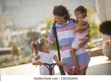 Sharing the perfect mother-daughter relationship. Single mother on city street walking with her daughter and having conversation. Close up. copy space.