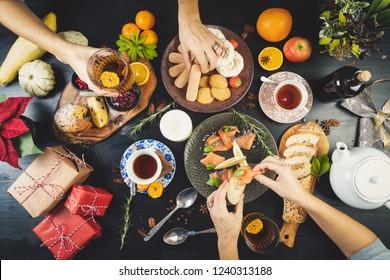 Sharing table food Christmas holidays tea cakes smoked salmon
