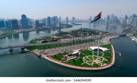 sharjah city flags island from sky