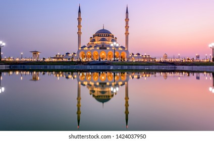 Sharjah Mosque. The Largest Mosque in Sharjah. Letters in Arabic means - Indeed, prayer has been decreed upon the believers a decree of specified times. Quran surah An Nisa [4:103]