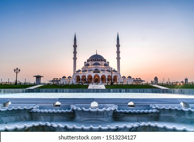 Sharjah Mosque Largest Mosque in United Arab Emirates Place to visit in Sharjah, Arabic Letter means: Indeed, prayer has been decreed upon the believers a decree of specified times