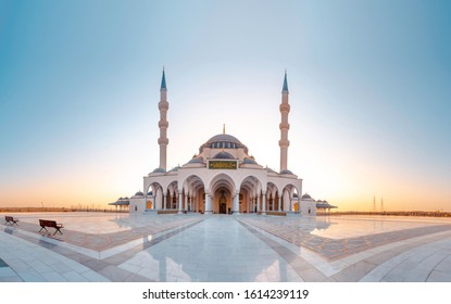 Sharjah New Mosque Famous Tourist attraction In Dubai, Arabic Letter means: Indeed, prayer has been decreed upon the believers a decree of specified times, Sharjah and Dubai Tourism concept Image