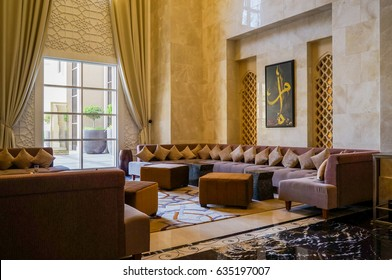 Sharjah. In the summer of 2016. Modern and bright interior marble decoration in the hotel Sheraton Sharjah Beach Resort Spa. The furniture in the interior is beige. Bright carpet on the floor.