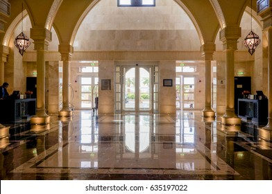 Sharjah. In the summer of 2016. Modern and bright interior marble decoration in the hotel Sheraton Sharjah Beach Resort Spa. Hall with columns in the interior.