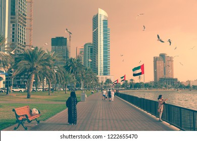 SHARJAH, UAE - DECEMBER 10, 2017: People visit the waterfront in Sharjah, UAE. This third populous city of UAE is the capital of Emirate of Sharjah.